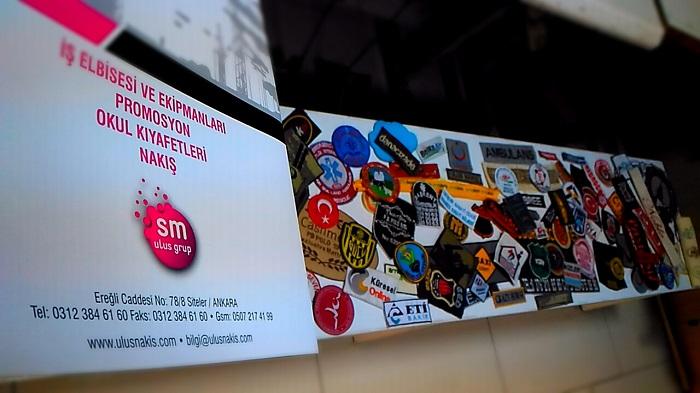 Sm Ulus Nakış Tekstil, mikrofon süngere logo